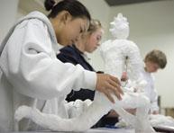 Student creating a sculpture