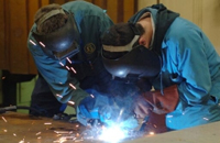 Students using a blow torch